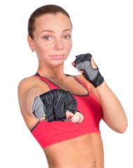Young beautiful sexy boxer woman making kick with boxing bandage