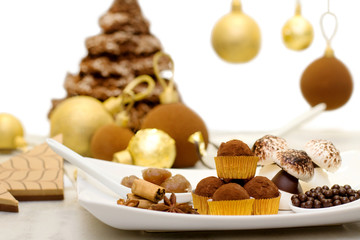 christmas sweets, meringue and chocolate bauble with christmas c