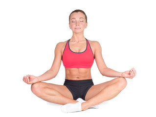 Young woman in a lotus position smiling. Relaxed woman