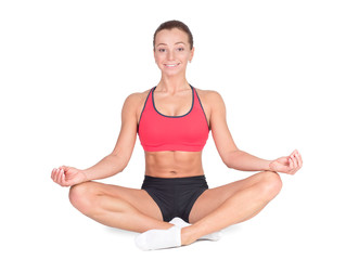 sport and lifestyle concept - Young woman in a lotus position