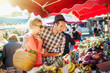 a young couple buying fruits and vegetables at a market - 73801162