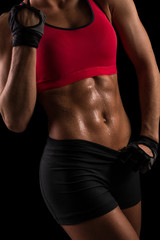Close-up of the abdominal muscles of young sporty woman.