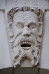 A face of a man as decoration on the loggia in Brescia