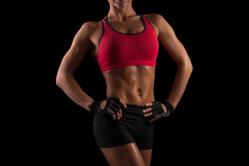 Woman with muscles posing. Young sporty woman.
