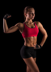 fitness young sporty woman with sporty body showing muscles.
