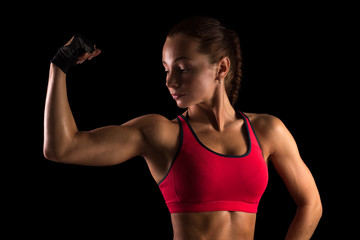 Woman body builder showing muscles