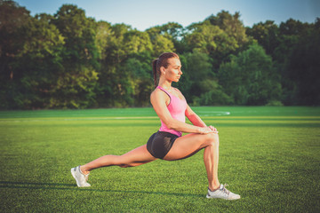 Young woman practicing or exercising. Woman doing sports