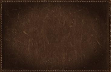 Dark brown grunge background from distress leather texture