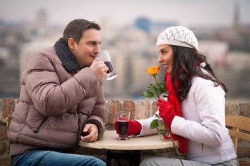 Romantic young couple drinking mulled wine