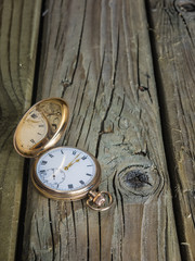 Antique pocket watch  on aged wooden boards