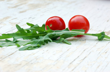 rocket salad and cherry tomatoes on a grunge table