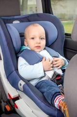 Cute boy sitting in the car seat