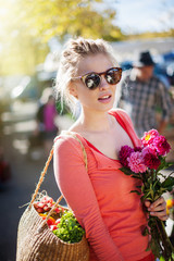 Portrait of a young woman doing shopping in a market