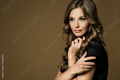 canvas print picture Beautiful young woman with long brown hair. Pretty model poses a