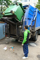 Loading of the garbage container, real photo.