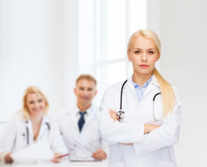 serious female doctor with stethoscope