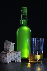 Cider bottle with Cabrales cheese.