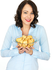 Young Woman Holding a Bowl of Roast Potatoes