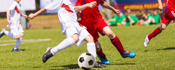 Football match for children. Boys playing football tournament