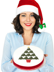 Young Woman in Santa Hat Holding a Christmas Fruit Cake