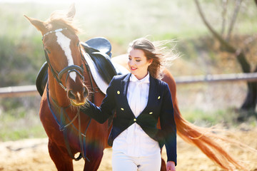 Beautiful girl with horse outdoors