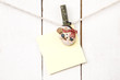 Christmas snowman clothespins holding blank note paper