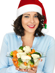 Young Woman in Santa Hat Holding Bowl of Cooked Mixed Vegetables