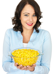 Young Woman Holding a Bowl of Sweetcorn