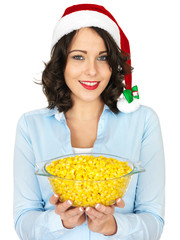 Young Woman in Santa Hat Holding a Bowl of Sweetcorn