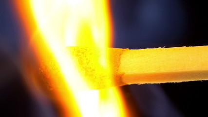 Macro shot of burning matches heads. 4K UHD 2160p footage.