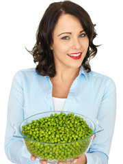 Young Woman Holding a Bowl of Peas