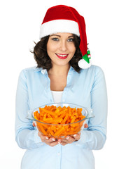 Young Woman in Santa Hat Holding a Bowl of Carrots