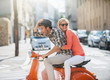 glamorous couple on a scooter in the street - 73808712
