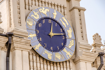 the tower clock close up with the signs of the Zodiac