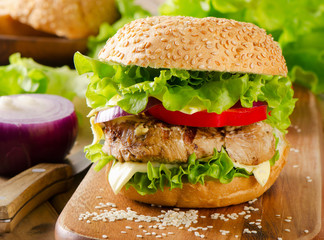 Homemade healthy hamburger with fresh vegetables.