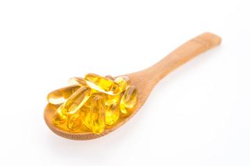 Fish oil in wooden spoon