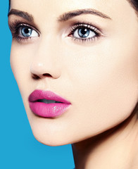 sensual beautiful model with  makeup on blue background