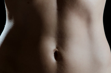 Stomach of young caucasian woman