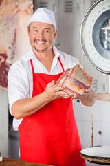 Butcher Showing Meat In Butchery