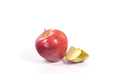 quarter of an apple next to a whole apple