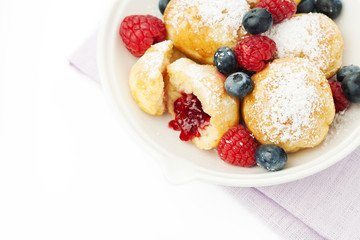 Traditional danish pancakes - ebelskivers with fresh berries