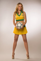 beautiful sexy blond cheerleader whit soccer ball