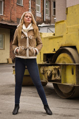casual woman with road roller on a background