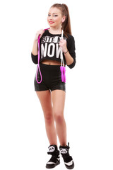 Attractive sporty woman posing holding a skipping rope on white