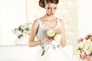 Gorgeous bride in a white room, posing