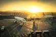 Leinwanddruck Bild - Airplane at the terminal gate in international airport