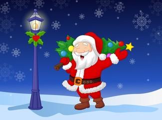 Santa carrying a Christmas tree