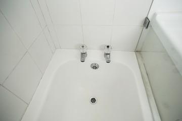 Overhead of white bath tub