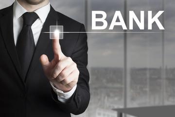 businessman pushing button bank
