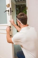 Man fixing locks with screwdriver
